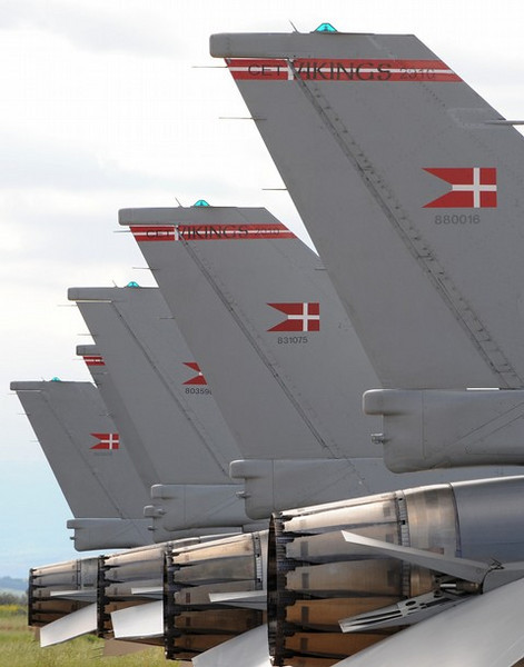 "Picture taken on March 20, 2011 shows danish F-16 fighters at the Italian military airport of Sigonella. Six Danish aircrafts are ready to take off from Italy's Sigonella air base to join the international air campaign against Moamer Kadhafi's forces in Libya, ANSA quoted a senior Italian military official as saying today. Italian Prime Minister Silvio Berlusconi told a crisis summit on Libya in Paris that his country was offering its military bases ""for now"" but did not rule out a bigger participation later. AFP PHOTO/MARIO LAPORTA (Photo credit should read MARIO LAPORTA/AFP/Getty Images)"