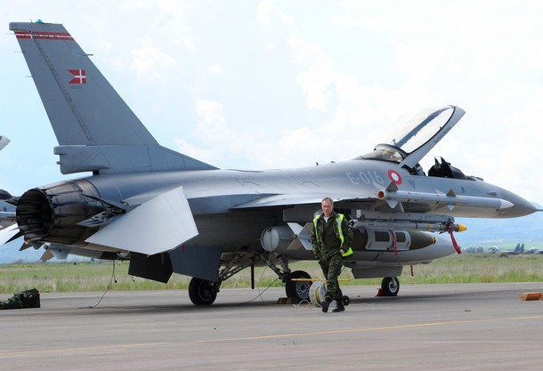 A technician walks past one of six Danish F16 fighter based at the Italian military airport of Sigonella, southern Italy on March 20, 2011.  Six Danish F-16 fighter are ready to take off from Italy's Sigonella air base to join the international air campaign against Moamer Kadhafi's forces in Libya, ANSA quoted a senior Italian military official as saying.AFP PHOTO/MARIO LAPORTA (Photo credit should read MARIO LAPORTA/AFP/Getty Images)