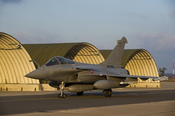 A French Dassault Rafale combat aircraft, seen in this photo released by ECPAD (French Defence communication and audiovisual production agency), taxis to its hangar at the Saint-Dizier military base, eastern France, after a mission to overfly Libya March 19, 2011. Western forces hit targets along the Libyan coast on Saturday, using strikes from  air and sea to force Muammar Gaddafi's troops to cease fire and end attacks on civilians.      REUTERS/ECPAD/Sebastien Dupont  (FRANCE - Tags: POLITICS MILITARY TRANSPORT) FOR EDITORIAL USE ONLY. NOT FOR SALE FOR MARKETING OR ADVERTISING CAMPAIGNS. THIS IMAGE HAS BEEN SUPPLIED BY A THIRD PARTY. IT IS DISTRIBUTED, EXACTLY AS RECEIVED BY REUTERS, AS A SERVICE TO CLIENTS