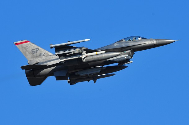 """A US F16 plane takes off from the Aviano air base on March 21, 2011. Western and Arab warplanes were converging on Italy's air bases to join the international campaign to cripple the ability of Moamer Kadhafi's forces to attack Libyan civilians in the UN-mandated Operation """"Odyssey Dawn"""" with air strikes on Libya.  AFP PHOTO / GIUSEPPE CACACE (Photo credit should read GIUSEPPE CACACE/AFP/Getty Images)"""