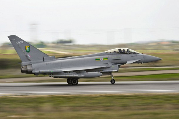 A British Royal Air Force (RAF) Typhoon aircraft is flown from the Gioia Dell Colle Air Base, in Italy March 22, 2011. The cost of Britain's involvement in military operations in Libya is likely to be measured in tens of millions of pounds rather than hundreds of millions, finance minister George Osborne said on Tuesday.   REUTERS/SAC Neil Chapman/MoD/Crown Copyright/Handout    (ITALY - Tags: MILITARY POLITICS CONFLICT) NO SALES. NO ARCHIVES. FOR EDITORIAL USE ONLY. NOT FOR SALE FOR MARKETING OR ADVERTISING CAMPAIGNS. THIS IMAGE HAS BEEN SUPPLIED BY A THIRD PARTY. IT IS DISTRIBUTED, EXACTLY AS RECEIVED BY REUTERS, AS A SERVICE TO CLIENTS