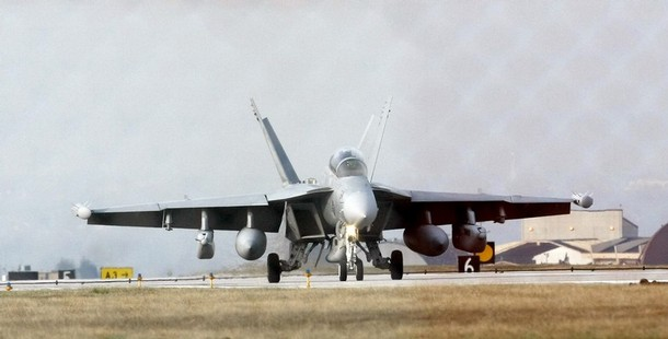 """An EA-18G Growler jet fighter lands at the Nato airbase in Aviano, northern Italy, March 19, 2011. The international community must fast over the situation in Libya, a French government source said on Saturday after forces loyal to Libyan leader Muammar Gaddafi attacked the rebel-held city of Benghazi. A NATO diplomat said no decision on whether NATO should act was expected before Sunday but added: """" Obviously the pressure is building to do something now"""". Picture taken through a fence.   REUTERS/Alessandro Garofalo  (ITALY - Tags: POLITICS MILITARY)"""