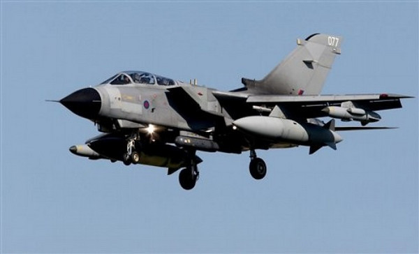 "An RAF Tornado aircraft flies into RAF Marham, south east England Saturday March 19, 2011. British Prime Minister David Cameron ordered RAF Typhoon and Tornado fighter jets to deploy to the Mediterranean to help impose a no-fly zone in Libya authorized by United Nations Security Council resolution 1973, which said ""all necessary measures"" short of military occupation should be taken to protect civilians from forces loyal toMoammar Gadhafi.  (AP Photo/Chris Radburn/PA Wire)  UNITED KINGDOM OUT NO SALES NO ARCHIVE"