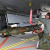 This photo provided by the French Army shows  a soldier fixing a GBU.12 bomb on a French Mirage 2000 jet fighter at the military base of Nancy, eastern France, Saturday, March 19, 2011. Top officials from the United States, Europe and the Arab world have launched immediate military action to protect civilians as Libyan leader Moammar Gadhafi's forces attacked the heart of the country's rebel uprising. The Mirages 2000 are operating over Libya. (AP Photo/ SIRPA AIR) NO SALES