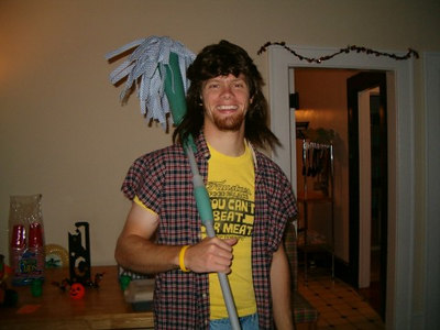 Yep, that's my brother making the family proud: Mulllet wearing redneck, Halloween 2005
