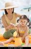 TA11.1 / Contemporary realistic photo of person putting on sunscreen<br /> <br /> Choice 13 of 21<br /> <br /> B3B2TP Asian mother applying sunscreen to daughter