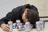 TA13.9 / Photo of intoxicated male who is passed out or getting help from friends<br /> <br /> Choice  6 of 9<br /> <br /> Drunk White young man drinking beer slumps on table cluttered with empty cans of beer, Santa Monica, CA