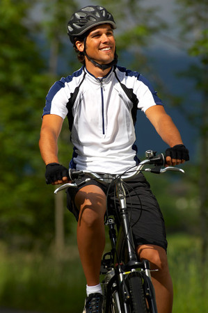 TA4.1 / New Chapter Opening photo, contemporary photo of a person biking, must be wearing a helmet<br /> <br /> Choice 1 of 16<br /> <br /> Germany, Bavaria, Walchensee, Man mountain biking