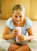 TA8.7 / Chubby child drinking juice box / This was hard to find! If these don't work, please let me know.<br /> <br /> Choice 12 of 15<br /> <br /> Girl drinking a milk shake --- Image by © Ocean/Corbis