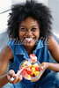 TA8.1 / Colorful Chapter Opener of ethnic minority woman eating healthy food<br /> <br /> Choice 3 of 12<br /> <br /> 700-00099140<br /> © Randi Sidman-Moore<br /> Model Release: Yes<br /> Property Release: No<br /> Model Release<br /> Woman Eating Fruit Salad
