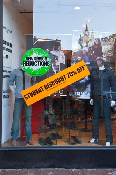 TA1.9 / Photo of a sign in a window or something else indiciating a student discount for Financial Wellness Strategies Box.<br /> <br /> BH5WJF A sign advertising student discounts in the envy clothing shop store in Norwich , Norfolk , England , Britain , Uk