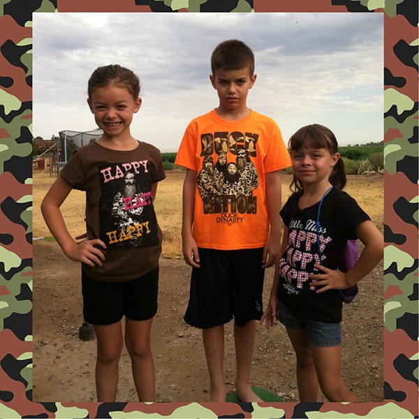 Tuesday, July 16, 2013 - Happy Happy Happy! Bri, Jackson and Cassie Barney showing off their new Duck Dynasty shirts!