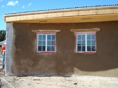 The final lime wash with pigment is applied with a brush.  You can apply several layers of lime wash to the walls which makes the wall very hard and durable.