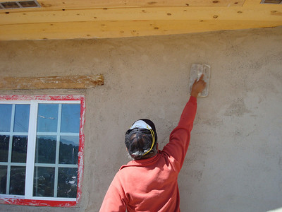 "The final layer of plaster is applied and then ""wood floated"" to give the plaster a smooth finish.  It is like a light massage and Alan Toledo has the right touch!"