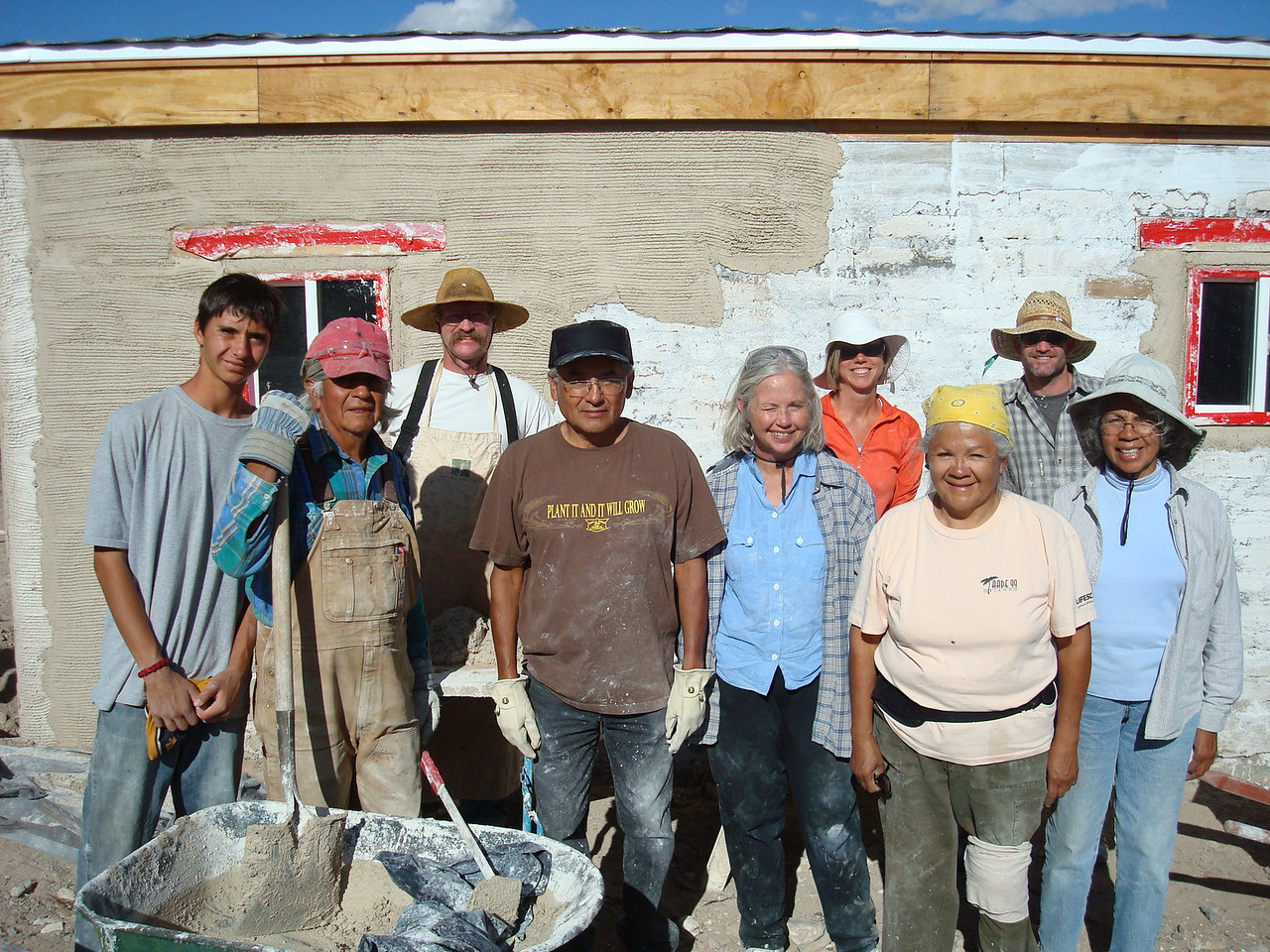 Lime Stucco seminar participants. From left to right, Raine Littlebird, Larry Littlebird, Tim White, Alan Toledo (Jemez Pueblo), Patty Wasterman, Laura Mack, Wilma Toledo (Jemez Pueblo), Daniel Goldthwaite, Mary Toledo Tang (Jemez Pueblo). Not in picture, three Pueblo men and photographer, Deborah Littlebird.