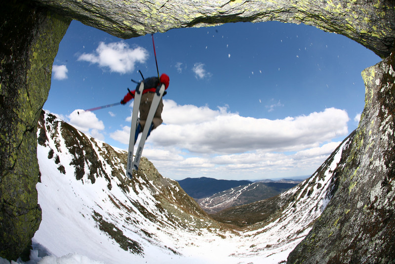 """Tuckerman Ravine in New Hampshire has provided an extreme-skiing haven for New England enthusiasts since the first recorded decent in 1899. Kurt Schuler of Windham, New Hampshire continues the tradition with a plunge over """"The Chute"""" in mid-May. (Photo featured as """"Postcard from Bates"""" in the spring issue of Bates Magazine)"""