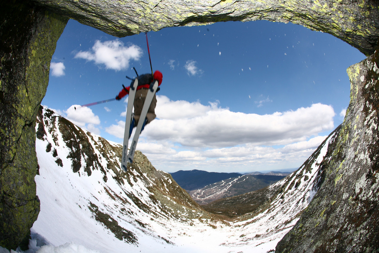 "Tuckerman Ravine in New Hampshire has provided an extreme-skiing haven for New England enthusiasts since the first recorded decent in 1899. Kurt Schuler of Windham, New Hampshire continues the tradition with a plunge over ""The Chute"" in mid-May. (Photo featured as ""Postcard from Bates"" in the spring issue of Bates Magazine)"