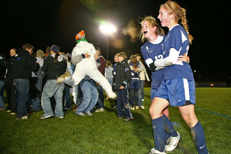 Surrounded by the thrill of victory, Katherine Rasche and Emma Clark celebrate York High School's 2-1 win over Winslow High School at the class B Girl's Soccer State Championship Friday night in Lewiston. (Photo used in The Portsmouth Herald)
