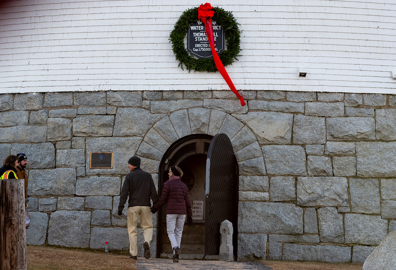Bangor, ME -- December 7, 2018 -- Visitors enter the Thomas Hill Standpipe for the annual holiday tour where people can climb the 100-stair-staircase and enjoy views of Bangor from the promenade deck.  Bangor Water opens the standpipe for tours four times a year, once each season.<br /> Linda Coan O'Kresik | BDN
