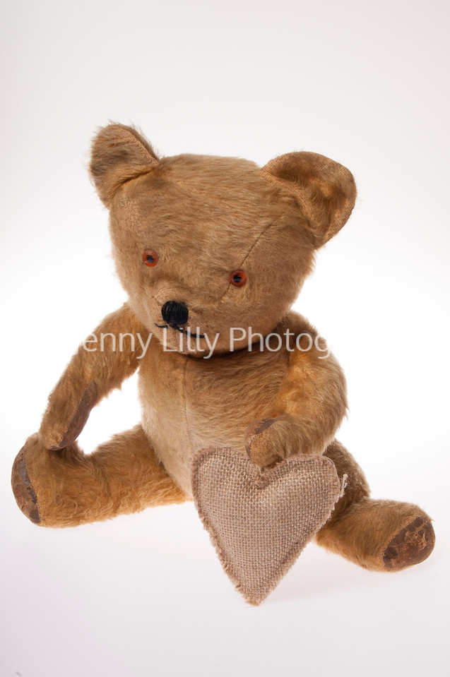 Vintage teddy bear with hessian Valentine heart isolated on white background