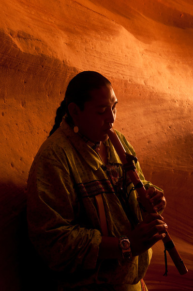 Indian Guide Playing the Flute Inside Antelope Canyon, near Page, Arizona.