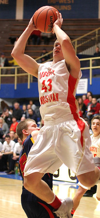 Photo by Chris Martin<br /> Liberty Christian's Vincent Phillips drives by Seton defenders for a layup