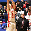 Photo by Chris Martin<br /> Liberty Christian Head Coach Jason Chappell watches on as Isaiah Tufts sinks a 3 pointer