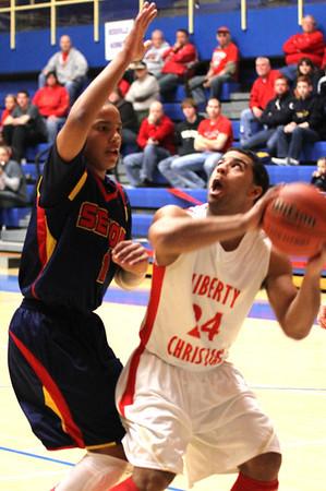 Photo by Chris Martin<br /> Liberty Christian's DeShon Gibbs drives to the basket against a Seton defender.