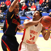 Photo by Chris Martin<br /> Liberty Christian's DeShon Gibbs drives to the basket against a Seton defender.