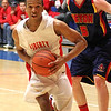 Photo by Chris Martin<br /> Liberty Christian's Chris Nunn drives past two Seton defenders in Saturday's Regional win.