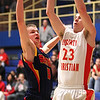 Photo by Chris Martin<br /> Liberty Christian's Ben Bowen puts a rebound back up for a basket against Seton in a Regional win Saturday morning.