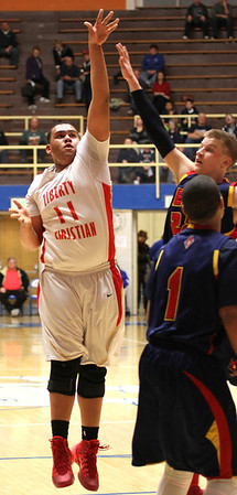 Photo by Chris Martin<br /> Liberty Christian's Quincey Hyatt hits a jumper in Saturday morning's Regional win.