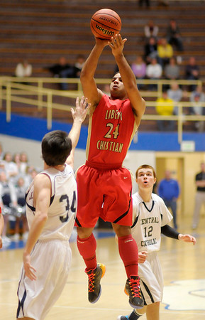 Don Knight / The Herald Bulletin<br /> Liberty Christian's DeShon Gibbs shoots as the Lions faced Lafayette Central Catholic in the regional championship at Frankfort High School on Saturday.