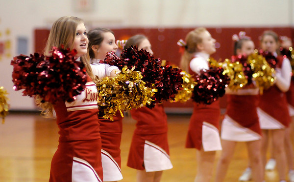 Don Knight / The Herald Bulletin<br /> Liberty Christian's cheerleaders lead the crowd as they sing the school song during a pep session after the Lions defeated Lafayette Central Catholic to claim their first regional title.