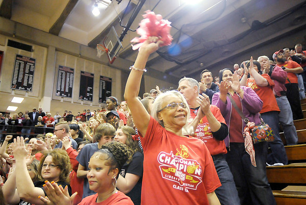 Don Knight / The Herald Bulletin<br /> A Liberty Christian fan cheers on the team as they faced Marquette Catholic in the 1A semi-state at Lafayette Jefferson on Saturday.