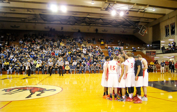 Don Knight / The Herald Bulletin<br /> In a demonstration of their selfless play the Lions walk onto the court together as a unit as the announcer called the names of the starting five during the 1A semi-state at Lafayette Jefferson on Saturday.