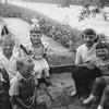 Mike Hoskins, Billy Hoskins, Bonnie Hoskins, Rose Rita Truempi, and Lisa Von Arx at Joe and Verna Von Arx's farm.  - age 4?