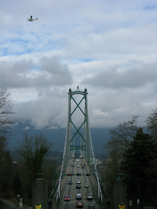 Lions-gate bridge Vancouver BC w/seaplane and lions with saftey jerseys on....