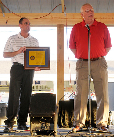 Sales Manager Mike Wren and Plant Manager Tom Stramer accept a Community Image Award on behalf of Prairie Farms Dairy.