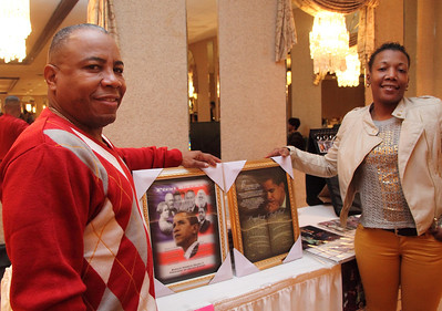 Yato Segun and his daughter Talona Thomas are among vendors selling President Obama memorabilia at the Old School Lorain Groove inauguration party.   photo by Ray Riedel