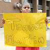 "Don Knight/The Herald Bulletin<br /> Mareon Harris, 11, hold a sign as he protests ""Stand Your Ground"" laws with the group Friends of Trayvon."