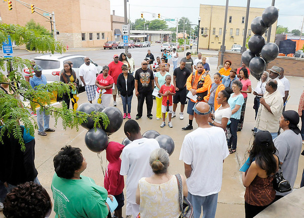 Don Knight/The Herald Bulletin<br /> The Unity Leadership Coalition held a rally outside the Madison County Government Center on Saturday to remember Trayvon Martin and call the community to action.