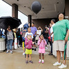 Don Knight/The Herald Bulletin<br /> Seventeen balloons were released, one for each year of Trayvon Martin's life, at the end of the rally.