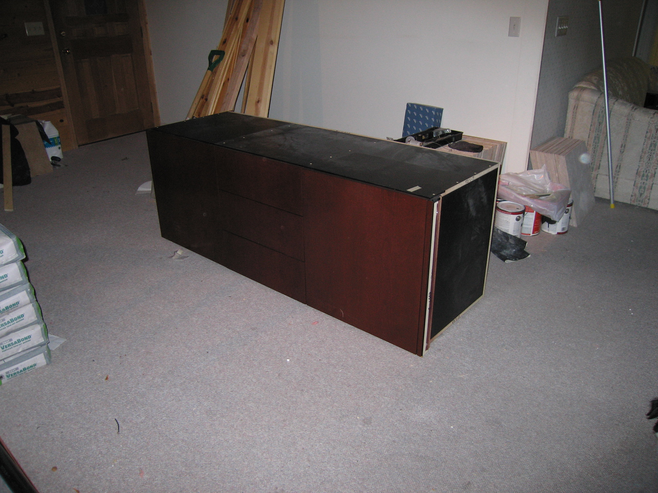 April 14, 2005 - I picked up the vanity base for the bathroom.  Scott came over to help us unload it.