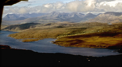 The Black Cuillin from the head of Loch Eishort, the houses of Heaste straggling down to the sea.
