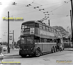 London Transport Class K1 trolleybuses Nos. 1107 and 1146 wait at the Hounslow terminus of route 657 from Shepherds Bush during the last couple of weeks of operation on Saturday 28th April 1962. BWNeg45.