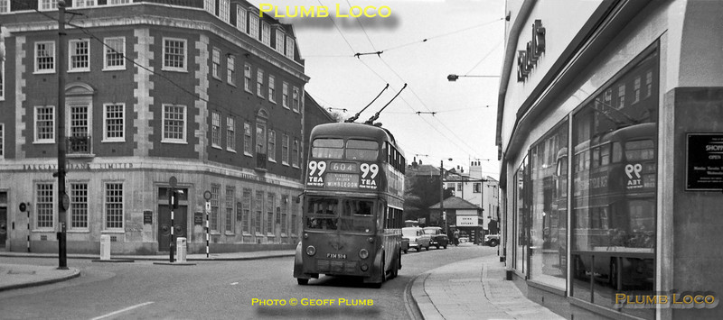 LT Trolleybus No. 1514, Class L3, passes the windows of Bentall's department store in Kingston High Street, soon after crossing the bridge over the River Thames whilst working route 604 from Hampton Court to Wimbledon on Sunday 6th May 1962. BWNeg31.