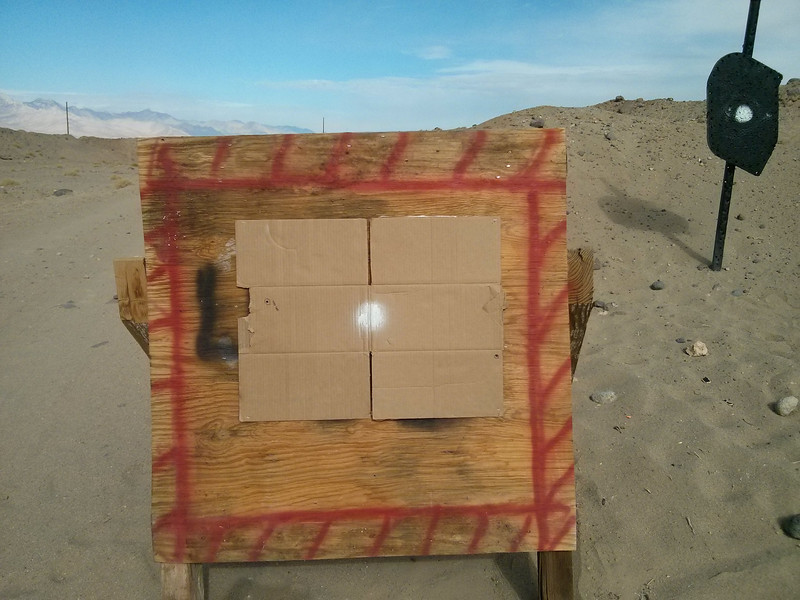 I couldn't seem to figure out where the bullets were going out at 600 yards, so I set up the target board and stapled a cardboard box to it.<br /> <br /> I ranged it at 395 yards.<br /> <br /> The round hit about 11 1/2 inches left and a little high.
