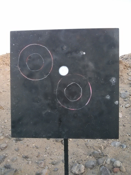 There was a little bit of a breeze, but not enough to move the bullets this far off of center. Obviously, I was pulling the shots.<br /> <br /> 4/5 at 600 yards.