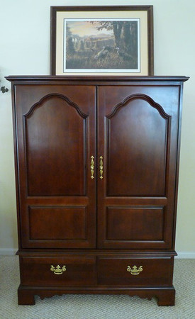 Immaculate TV Armoire  Don't need an armoire?  Add glass and shelves and make it a fantastic drinks cabinet!